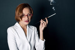 Woman smokes a cigaret Royalty Free Stock Images