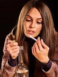 Woman smokes cigarette Royalty Free Stock Image