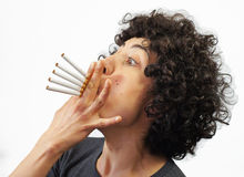 Woman smokes 5 cigarettes Royalty Free Stock Photo