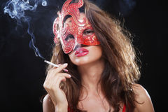 Woman smokes in the dark Stock Photo