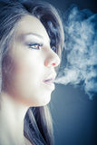 Woman smokes in the dark. Photo of a woman smokes in the dark Stock Photo