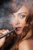 Woman smokes her vape pen Stock Photos
