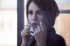 Woman smokes. Real young woman smokeing, selective focus Stock Images