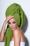 Woman with smokey makeup and green turban Royalty Free Stock Photo