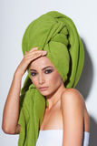 Woman with smokey makeup and green turban Stock Photography