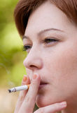 Woman smoking Stock Images
