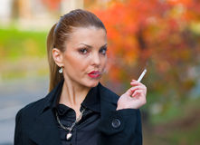 Woman smoking Royalty Free Stock Photography