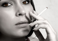 Woman smoking Royalty Free Stock Image