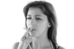 Woman is smoking Stock Images