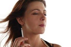 Woman is smoking Royalty Free Stock Photos