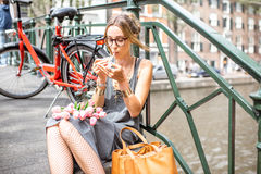 Woman smoking in Amsterdam city Stock Image