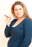 Woman is smoking Stock Photography