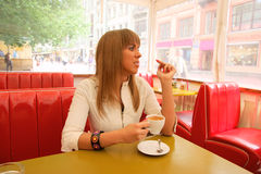 Woman smoking in cafe Royalty Free Stock Images