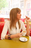 Woman smoking in cafe Stock Images