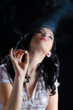 Woman Smoking a Cannabis Joint Royalty Free Stock Photos