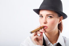 Woman smoking cigar Stock Image
