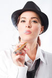 Woman smoking cigar Stock Photo