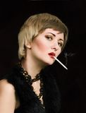 Woman with smoking cigarette Stock Image