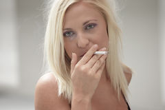 Woman smoking a cigarette Stock Photos