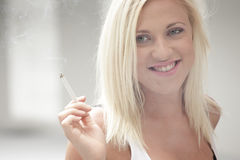 Woman smoking a cigarette Royalty Free Stock Photo