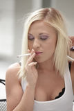 Woman smoking a cigarette Royalty Free Stock Photos