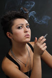 Woman smoking a cigarette Royalty Free Stock Photography