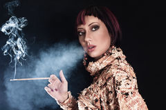 Woman smoking cigarette Stock Image