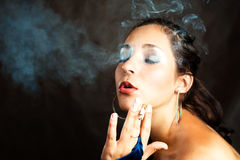 Woman smoking a cigarette Stock Photography