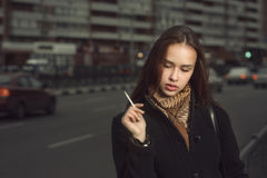 Woman smoking a cigarette Stock Photo