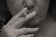 Woman Is Smoking A Cigarette Stock Photo
