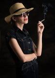 Woman Smoking a Cigarette Stock Photography
