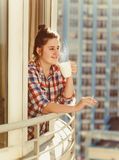 woman smoking cigarette and drinking coffee Royalty Free Stock Image
