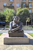 Woman Smoking a Cigarette by Fernando Botero. Cafesjian Museum of Art and the Cascade. Royalty Free Stock Photography