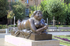 Woman Smoking a Cigarette by Fernando Botero. Cafesjian Museum of Art and the Cascade. Stock Image