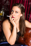 Woman smoking Stock Photography