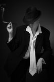 Woman smoking  cigarette in mouthpiece Stock Images