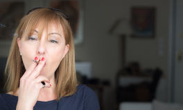 Woman smoking a cigarette. Stock Photos