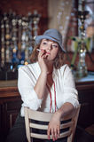 Woman smoking cigarette in restaurant Royalty Free Stock Photo