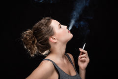 Woman smoking concept on black Royalty Free Stock Photos