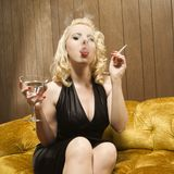 Woman smoking and drinking Royalty Free Stock Image