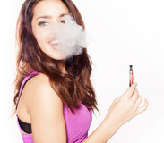 Woman smoking e-cigarette Royalty Free Stock Photos