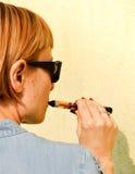 Woman smoking e-cigarette Stock Photo