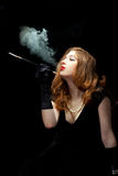 Woman smoking film noir Stock Photography