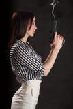 Woman smoking gun Stock Images