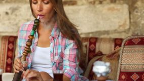 Woman smoking a hookah stock video footage