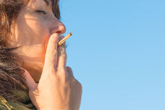 Woman smoking a joint Royalty Free Stock Image