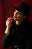 Woman smoking and looking away Royalty Free Stock Images
