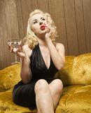 Woman smoking with martini. Stock Photos