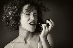 A woman smoking pipe Stock Photos