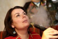 Woman smoking shisha Royalty Free Stock Photos